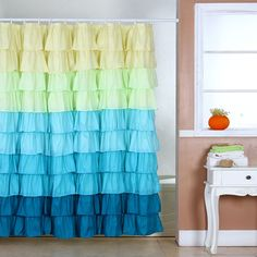 This colorful shower curtain showcases tiers of bright ruffles for a fun, cheerful look. Easily washable, this shower curtain is the perfect way to finish your bathroom in style.