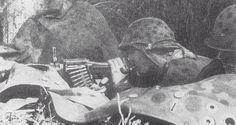 A member of the Frikorps Danmark on the Eastern Front with a MG34 while smoking a pipe.