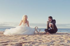 This is such a cute wedding photo from this fairy-tale Beach Wedding by Simple Maui Wedding.