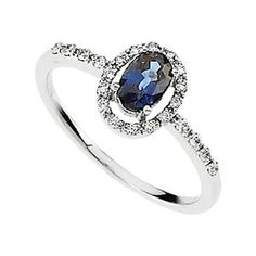 Nathalie's Jeweler How cute? An engagement ring with a different rock other than a diamond?