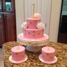 Pink and gold majestic first birthday cake and matching smash cakes.  https://www.facebook.com/sweetnsassycakesbyeva