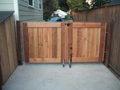 Here is a custom cedar driveway gate we built. The purpose was to act as a fence and keep the children in most of the time but to be able to open it occasionally to back the car up to the garage.