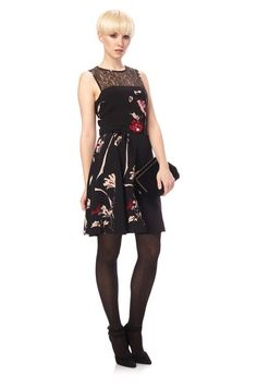 French Connection crepe and lace dress is a sweet style with a flared skirt for a ladylike silhouette. Pair with heels and statement clutch for party style.