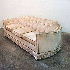 Cream Velour Tufted Regency Sofa $1250.........We offer a wide variety of furniture and accessories. We are located in the Dallas Design District. We can ship to any location in the US. visit us at www.againandagain.com  www.facebook.com/againdesign