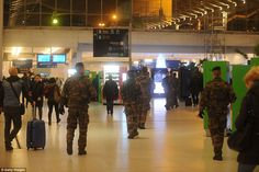 Maximum security: Troops patrol the Gare du Nord railway station as the hunt continued for two suspects in the Charlie Hebdo terror attack