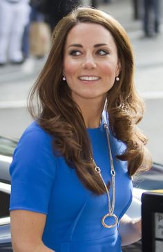 Kate Middleton at National Portrait Gallery...what a smile she always gives the world!!
