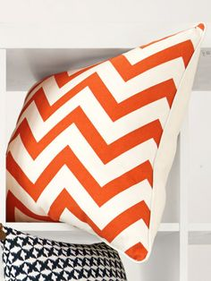 Looking to excite your living room #decor? Try this lively patterned chevron pillow.