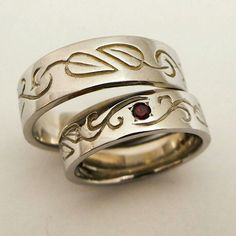 Special design inspired by one of my rings and made to match a unique couple.  14 karat white gold, Garnets and pure love.