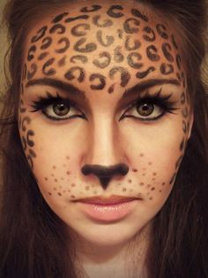 Leopard makeup for Halloween @Monica Forghani Forghani Gonzales this could be your costume dress in black and paint your face like this!!!!