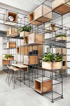 Steel rebar forms storage system at Toronto kitchen showroom - PIN SIX: Metal used as storage. The designer has created a clever and unique storage system for thi -