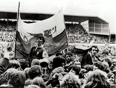 Barry John (left) and Gareth Edwards are chaired from the field by supporters after the 23-9 win over Ireland secured the Triple Crown in 1971
