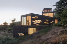 Architecture firm Prentiss + Balance + Wickline, have designed a multi-level, modern wood house in Friday Harbor, Washington State, that's anchored into the rocky slope.Stacked boxes that end in … Modern Wood House, Wooden House Design, Modern Family House, Cabin Design, Seattle Architecture, Modern Architecture, Architecture Quotes, Sustainable Architecture, House On A Hill
