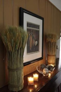 "LSJ.com suggests to ""Create sculptural appeal by putting vases with tall stalks of ornamental grass, bamboo or bare tree limbs next to the fireplace or on top of a mantel."" // HomeGoods stalk bunches in image."