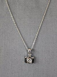 camera necklace... I also NEED this :)