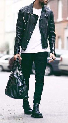 ablack leather jacket, black jeans, a white tee, black boots and a bag