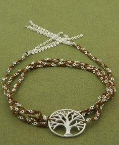 Tree of Life wrap bracelet made of silk and sterling silver. Spiritual jewelry available at BuddhaGroov.com.