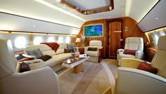 Comlux America's Airbus Corporate Jet 319 (ACJ319) custom interior was designed to provide passengers with a soothing, comfortable space that feels more like a home than the inside of a business jet. The jet's entryway is bright and welcoming, with an ornate floor. The aft main cabin is a dining area, a conference space, and a spacious lounge. Beyond that is a private space that can be used as an office or second bedroom, followed by the master bedroom with queen-size bed. A large mast...