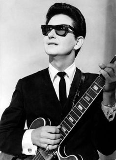 Lacking the photogenic looks of many of his rock & roll contemporaries, Roy Orbison developed a persona that didn't reflect his personality.  After leaving his thick eyeglasses on an airplane in '62, he was forced to wear his prescription sunglasses on stage and found that he preferred them. His biographers suggest that although he had a good sense of humor & was never morose, he was very shy and suffered from severe stage fright; wearing sunglasses helped him hide somewhat from the…
