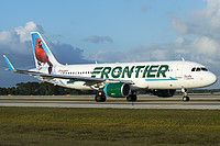 Frontier Airlines (US) Airbus A320-214(WL) N228FR aircraft,in the 2014 livfery, named ''Orville the Red Cardinal'', rolling to USA, Florida, Orlando Int'l Airport. 05/04/2015. (Red Cardinal or Northern Cardinal=a North American bird in the genus Cardinalis).