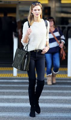 Karlie Kloss went for a classic look, styling her over-the-knee boots with skinny jeans and a comfy sweater.