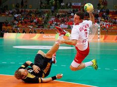Przemyslaw Krajewski of Poland battles for a ball with Steffen Weinhold of Germany during the bronze medal match in men's handball during the Rio 2016 Summer Olympic Games at Future Arena.    -  Best images from Aug. 21 at the Rio Olympics