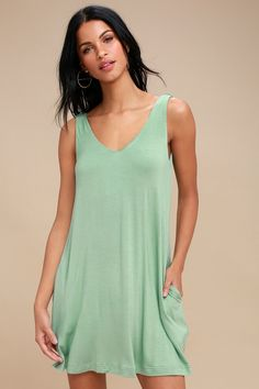 A sunhat and some sandals are all you need to go with the RVCA Chances Sage Green Sleeveless Swing Dress! Soft and stretchy jersey knit falls from a  V-neckline, into a sleeveless, swing bodice with side seam pockets and a mini hem. Deep V-back is accented with cool, twisted straps. Logo tag at back.