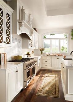 I do love a white kitchen...and that's a great window. :)