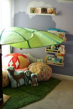 Love this idea for a kid's bedroom! Make a little space for reading under a LÖVA canopy | Plus keep books in BEKVÄM spice racks so they're easy to reach