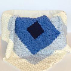 A Modern baby blanket - the Sqaures Baby Blanket in Blue Sky Alpaca Organic worsted cotton yarn - crochet pattern by Little Monkeys Design.