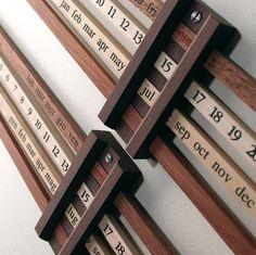Cool idea: Wooden slide rule style calendar.
