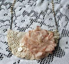 Sweet Treasures HANDMADE Crochet Bib Necklace with rosary beads and handmade flower. $19.95, via Etsy.