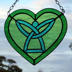 this reminds me of all my angels in Heaven. Stained Glass Celtic Angel Heart by neilsglass on Etsy