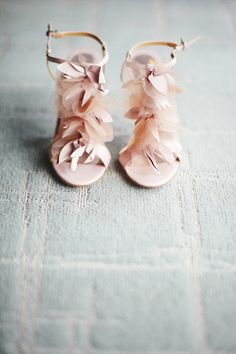 heels add feathers to shoes to dress them up ! cool idea !