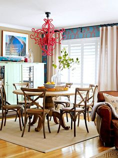 Such a fun, fresh room that blends serious and gutsy. Love the classic wooden table vs. the red wool wrapped chandy. And the wallpaper!