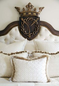 A custom, tufted headboard from Reborn Relics is the focal point of the master bedroom.
