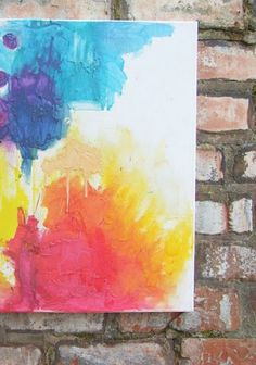 Make your home a colorful wonderland with this awesome melted crayon art project both kids and adults will LOVE!
