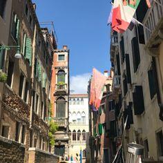 Venice, Italy through the view of a gondola.