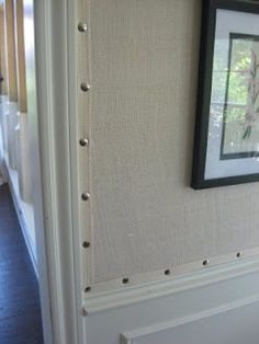 {Burlap stuck to walls with trim and nail heads from Kara's Cottage -  could be done with a pretty patterned fabric too}