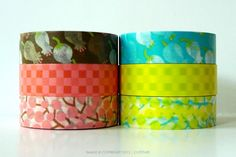 Cute set of 3 rolls of Lily of the Valley washi tape. Two color sets to choose from: brown/pink or aqua/yellow.15mmx12m per roll set of 3  $12.25