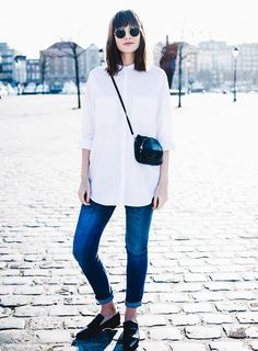 Pair a crisp white button-up with cuffed skinnies and you comfiest loafers for an effortlessly chic day look. A cross-body bag keeps things hands free and round frame sunglasses add a touch of personality, completing the look.