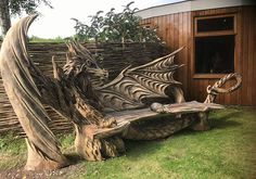 The Carving Of An Incredible Dragon Bench With The Aid Of A Chainsaw, And It Looks Wonderful And Unique