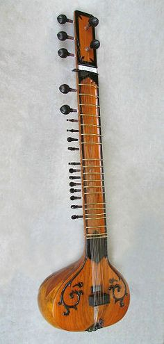 "The ""Don"" Sitar by Tony Karasek. Beautiful black trim! Tony went to India and set up a shop with the best craftspeople to create some of the highest quality, unique Indian stringed instruments made."