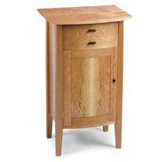 Ah! E se falando em madeira...: gabinete com frente arredondada