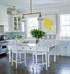 Vintage Frances Elkin stools and a grand table provide space to relax, work, and cook in Aerin Lauder's East Hampton home. Tour more of Erin Lauder's fabulous homes.