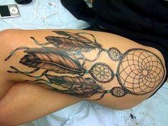 Dream catcher leg tattoo.