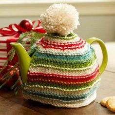 Warm Memories Tea Cozy | AllFreeKnitting.com Keep your tea and your hearts warm with this knit tea cozy pattern. This Warm Memories Tea Cozy will become an annual holiday decoration that will hold many fond memories and tea pots throughout the years.
