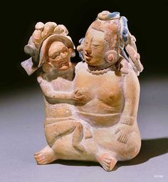 Maya. Jaina. clay with traces of paint.  height 15.2 cm. One of many versions of the Old God with the Moon Goddess in an amorous setting.