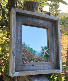 New Design...Beach glass mirror with barnboard frame. Handcrafted in a driftwood tone embellished with sea glass, shells and sand. One of a kind. Perfect for a beach lover 13 x 11 1/2