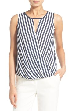 Nautical stripes in blue and white adorn this flowy tank that pairs perfectly with white denim on a sunny day.