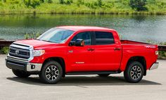 Hubby's New Wheels!  Red Tundra Truck...We'll cry when filling up! LOL!